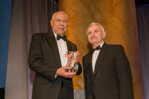 General Colin L. Powell (left) receives the Lifetime Achievement Award for Public Service from the 2011 recipient, Senator Jack Reed (R.I.)