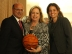 Rizzoti signs a basketball for Immediate Past National President Joseph DiTrapani and former first lady of OSIA Carol DiTrapani.